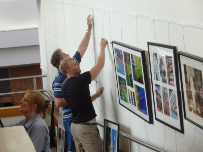 Hanging the 50th Anniversary Exhibit at St Ives Shopping Village